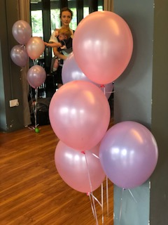 Pink and purple helium balloons